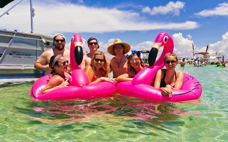 friends partying at crab island sandbar destin florida