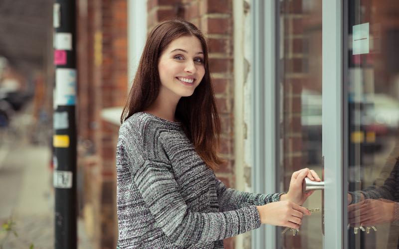 woman-opening-shop
