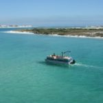 Destin boat rental traveling through crystal-clear waters