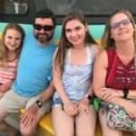 Family bonding on a Destin dolphin sightseeing cruise