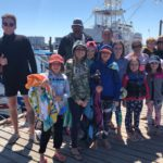 Group after a successful dolphin sightseeing tour in Destin