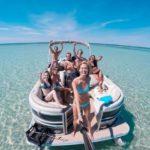 Group takes selfie aboard a Destin boat rental