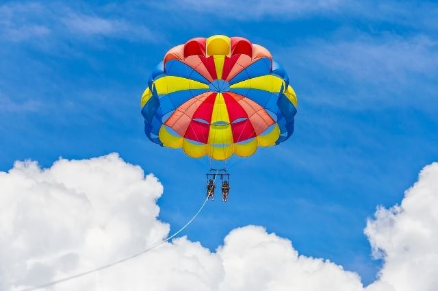 Parasail flying high in the sky over Destin