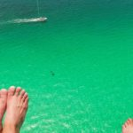 Parasailing over clear waters in Destin
