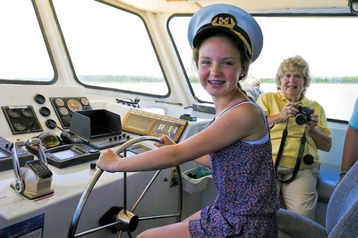 Passenger enjoys a photo-op during a Destin dolphin sightseeing cruise