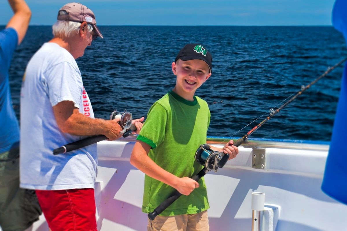 Young angler on a Destin semi-private fishing charter
