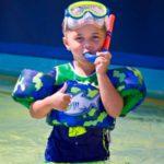 child snorkeling at Crab Island in Destin