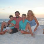 family photo shoot on the beach during sunset in Destin