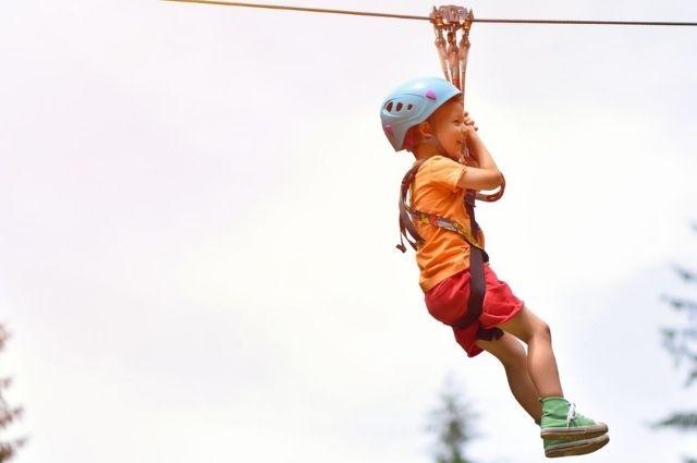 child ziplining at Baytowne Adventure Zone