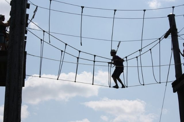 climbing the ropes course at Baytowne Adventure Zone