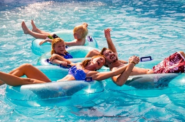 family floating down the lazy river at Big Kahuna's