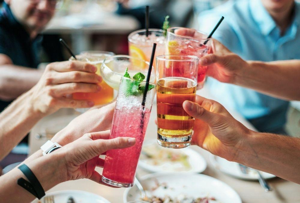 group makes a toast at Baytowne Wharf
