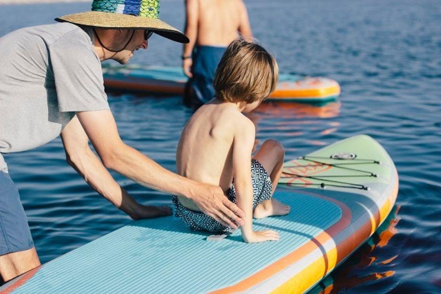 paddleboarding through Destin Harbor