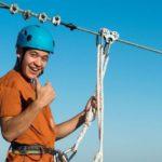 preparing to zipline at Baytowne Adventure Zone