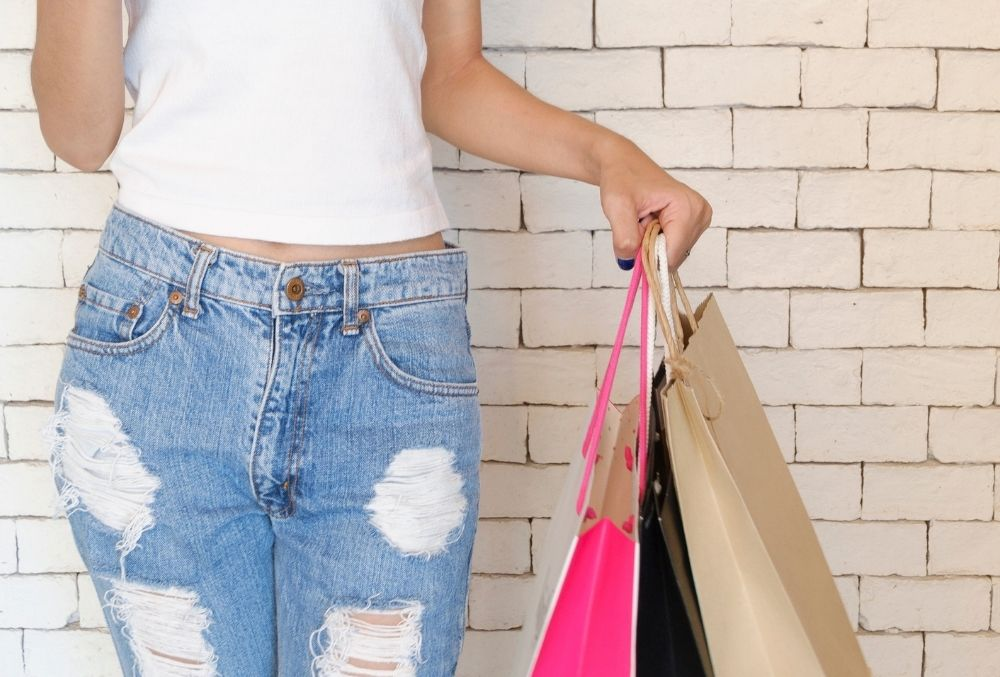 woman with shopping bags in Destin-FWB